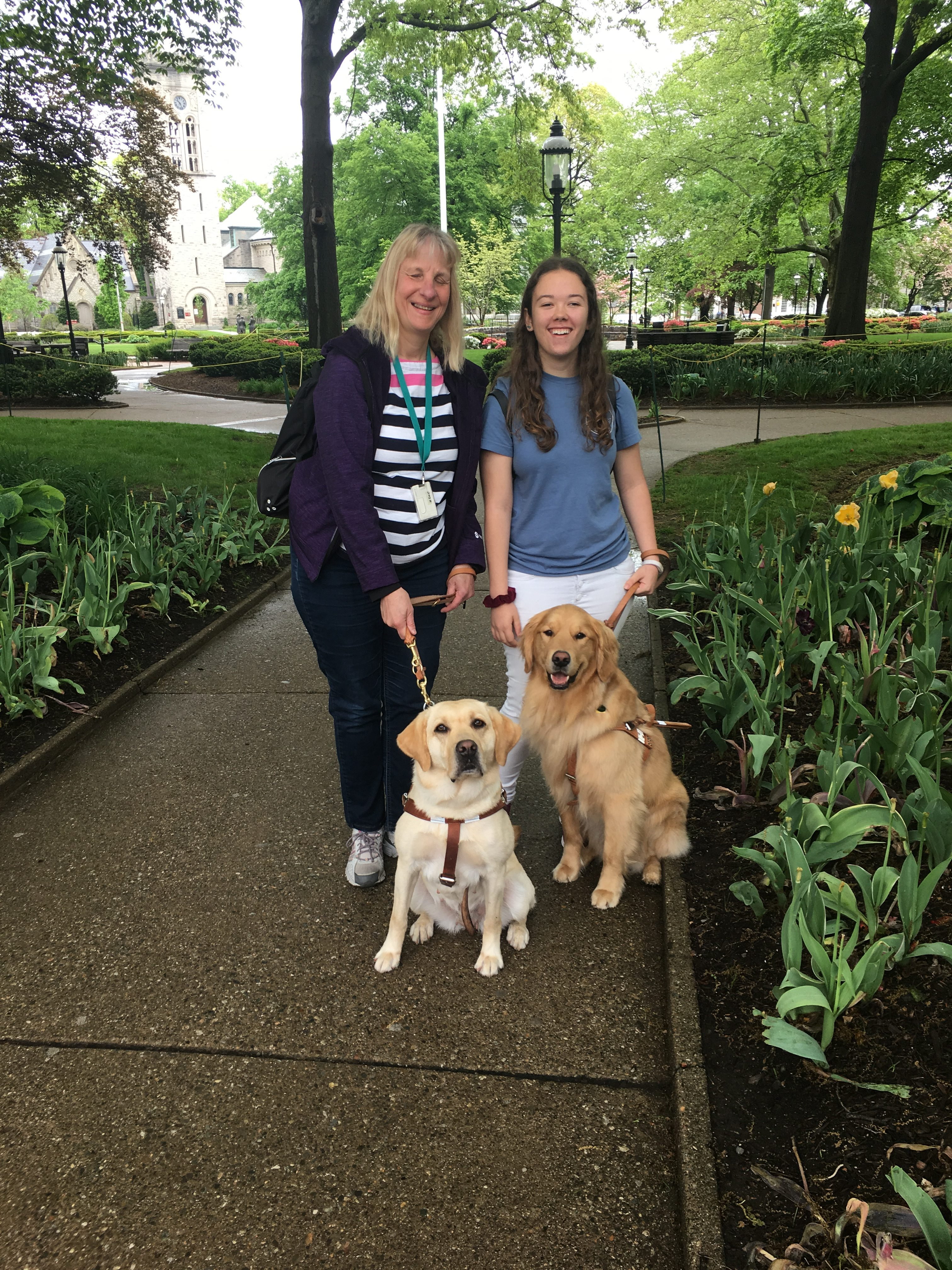 Judy and classmate, Shelbi, with their dogs in the park (Morristown Green)